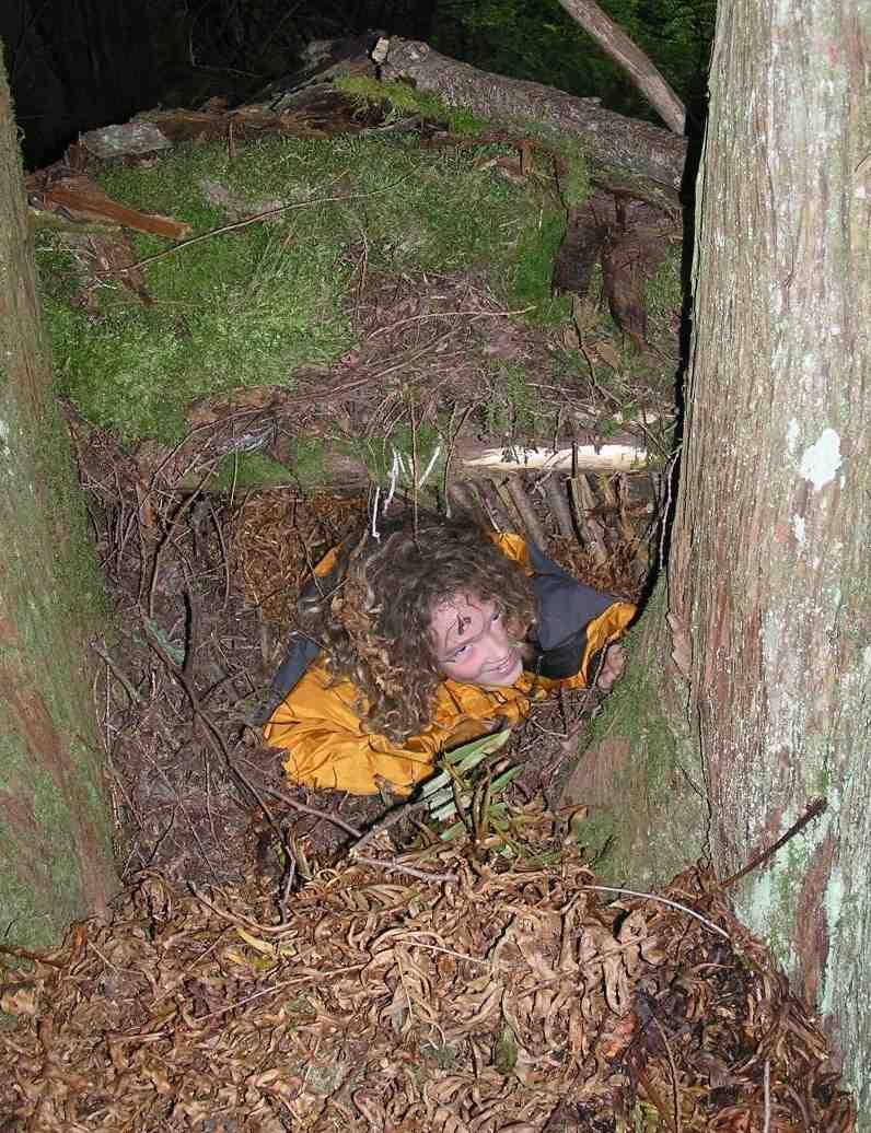 Camper Climbing Into Debris Hut