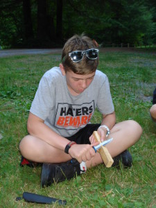 Overnight Youth Survival camper using a Mora knife. Mora of Sweden - our favorite/recommended outdoor adventure and survival knife.