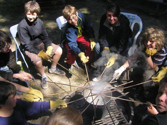 Artisan Camp learning how to safely steam bend arrows
